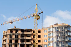 Construction of the new brick building by means of the elevating Royalty Free Stock Image