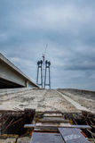 Construction of a new bridge. With columns across the Dnieper River on an overcast autumn day Royalty Free Stock Images