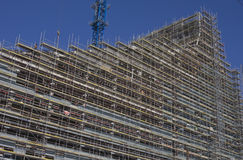 Construction of new building. With one crane in background Stock Images