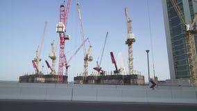 Construction of new buildings in the area of Dubai Marina stock footage video. Dubai, UAE - April 01, 2018: Construction of new buildings in the area of Dubai stock footage