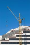Construction of new city build. Ing with tower crane on the foreground Stock Photo