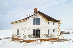 Construction of the new cottage. In field in winter season from white brick Stock Images