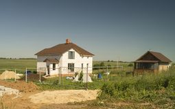 Construction of the new cottage. From white brick on background blue sky Stock Photo