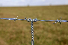 Construction of new fence. Detail of construction of new steel fence in farm on countryside in brazil Stock Image