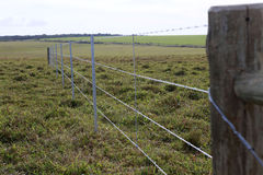 Construction of new fence. Detail of construction of new steel fence in farm on countryside in brazil Royalty Free Stock Images