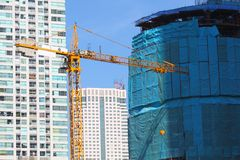 Construction of new glass. Building and crane Royalty Free Stock Image