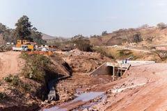 Construction New Highway Bridge. Construction new river flood zone highway bridge crossing halfway progress stock image
