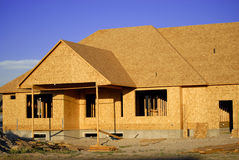 Construction of New Home. New home being built and detail of construction site Stock Photo