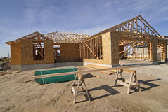 Construction of New Home. New home being built and detail of construction site Royalty Free Stock Photos