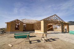 Construction of New Home. New home being built and detail of construction site Royalty Free Stock Images