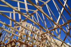 Construction of New Home. New home being built and detail of construction site Royalty Free Stock Photo