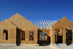 Construction of New Home. New home being built and detail of construction site Stock Image