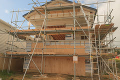 Construction of new home building. Auckland, New Zealand, horizontal photo, photo is usable on picture post card, calendar, gardening, magazine Royalty Free Stock Photo
