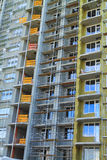 Construction of a new home on the stage facade insulation. KALININGRAD, RUSSIA — JUNE 17, 2014: Construction of a new home on the stage facade insulation Royalty Free Stock Photo