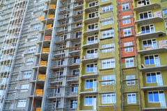 Construction of a new home on the stage facade insulation. KALININGRAD, RUSSIA — JUNE 17, 2014: Construction of a new home on the stage facade insulation Royalty Free Stock Images