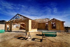 Construction of New Home in Subdivision. New home being built and detail of construction site in subdivision Stock Photo