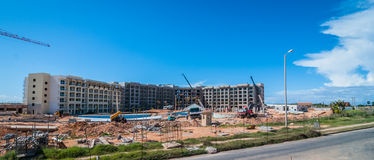 Construction of new hotel and resort.  Sunshine day for work. Royalty Free Stock Images