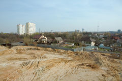 Construction of new house in city area. Construction of the new house in the new area in the city. high rise residential construction site in a city Royalty Free Stock Photo