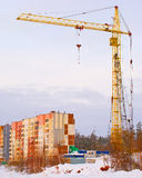Construction of new  house with crane. Construction of new dwelling house with tower crane Stock Photos