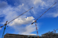 Cranes for building construction in Milan, Italy. Construction of new modern buildings in Milan, Italy Royalty Free Stock Photography