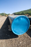 Construction of a new oil pipeline. Machine to twist pipes(pipelaying crane) in a pipeline construction stock image