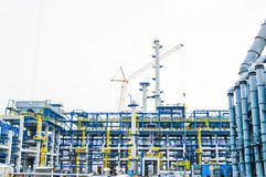 Construction of a new oil refinery, petrochemical plant with the help of large building cranes. Construction of a new process unit.  royalty free stock images