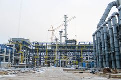 Construction of a new oil refinery, petrochemical plant with the help of large building cranes. Construction of a new process unit stock image