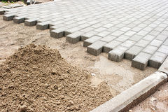 Construction of a new pavement of paving slabs royalty free stock images