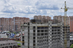 Construction of a new residential area. Construction of a new district. Multi-storey residential building under construction on the background of high-rise Stock Photography