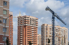 Construction of a new residential neighborhood. Construction crane on a background of a panorama of new residential buildings Stock Photography