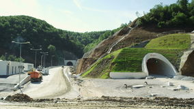 Construction of a new road next to the tunnel stock video
