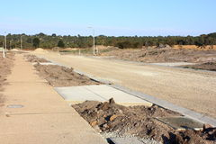 Construction of new road in subdivision Stock Photos