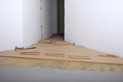Construction in a new room installation of parquet stock image