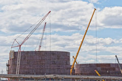 Construction of a new tank farm for storage of petroleum product. The construction of a new tank farm for storage of petroleum products method sheet Assembly Stock Images