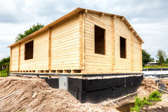 Construction of a new wooden house in summer day Stock Photos