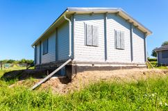 Construction of a new wooden house in summer day Stock Images