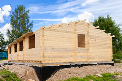 Construction of a new wooden house in summer day Royalty Free Stock Image