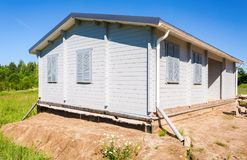 Construction of a new wooden house in summer day Royalty Free Stock Photo