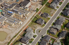 Construction Next to Suburban Street. Aerial view of new retail development behind quiet suburban homes Royalty Free Stock Images