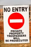 Construction No Entry Sign Fence. Construction apartments site of new building in progress with No Entry sign on boundary fence stock photos