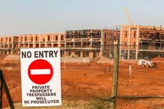 Construction No Entry Sign Fence. Construction apartments site of new building in progress with No Entry sign on boundary fence royalty free stock image