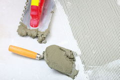 Construction notched trowel with mortar for tiles work Royalty Free Stock Photo