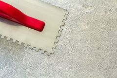 Construction notched trowel is a tool for tiles installation wor Stock Photography