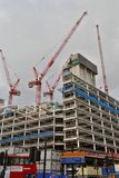Cranes large building construction site development Royalty Free Stock Photography