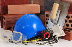 Construction objects. Different construction bricks with safety objects Royalty Free Stock Photos