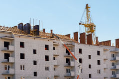 Construction Of Multistory Building. Covering Roof Royalty Free Stock Image