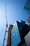 Construction office building. Crane over a construction site of an office building royalty free stock image