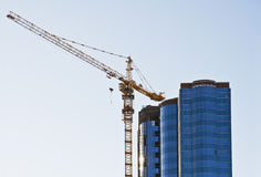 Construction of office building. Photos of building an office building. Detail of the building and the tower crane Royalty Free Stock Images