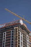 Construction of Office Building. With yellow crane Stock Photos