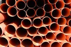 Construction orange pipes stock image